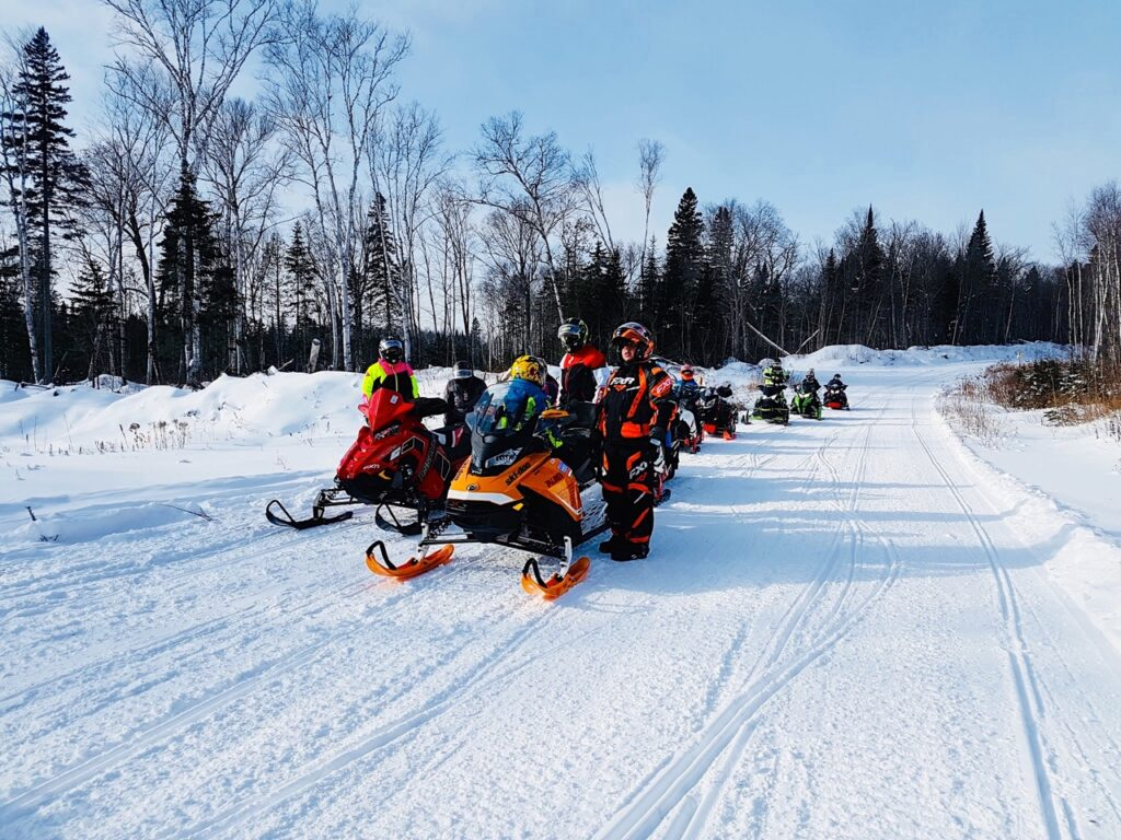 Family & friends enjoying Christmas snowmobiling in Lanaudière Quebec