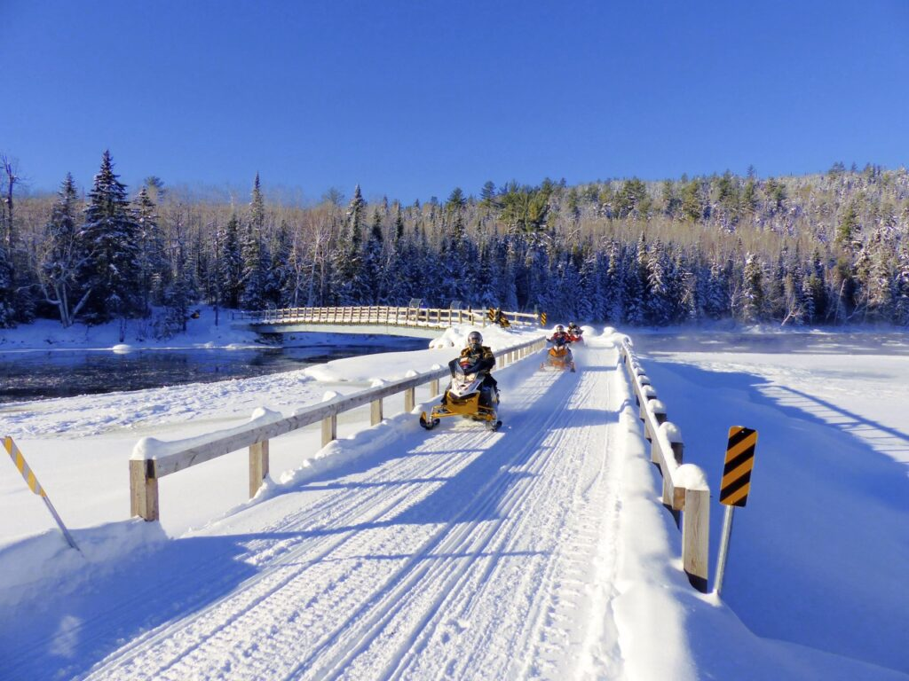Christmas snowmobiling includes many scenic bridge crossings