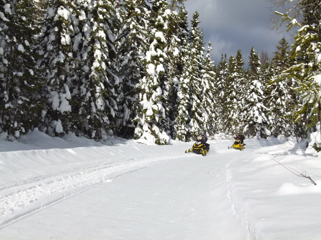 Christmas snowmobiling on snowy Lanaudière Quebec trail