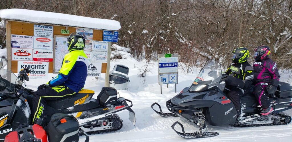 Snowmobile Midwestern Ontario with great intersection sign boards