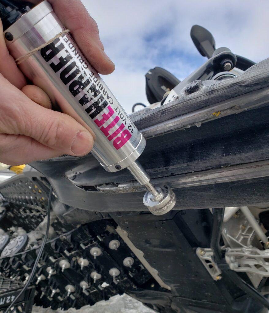 Sharpening snowmobile carbides with a BiteHarder 12-Volt Carbide Grinder