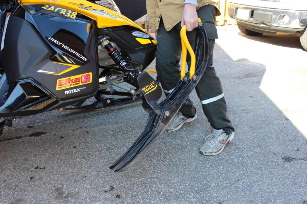 For sharpening snowmobile carbides, lift the sled up by the ski handle