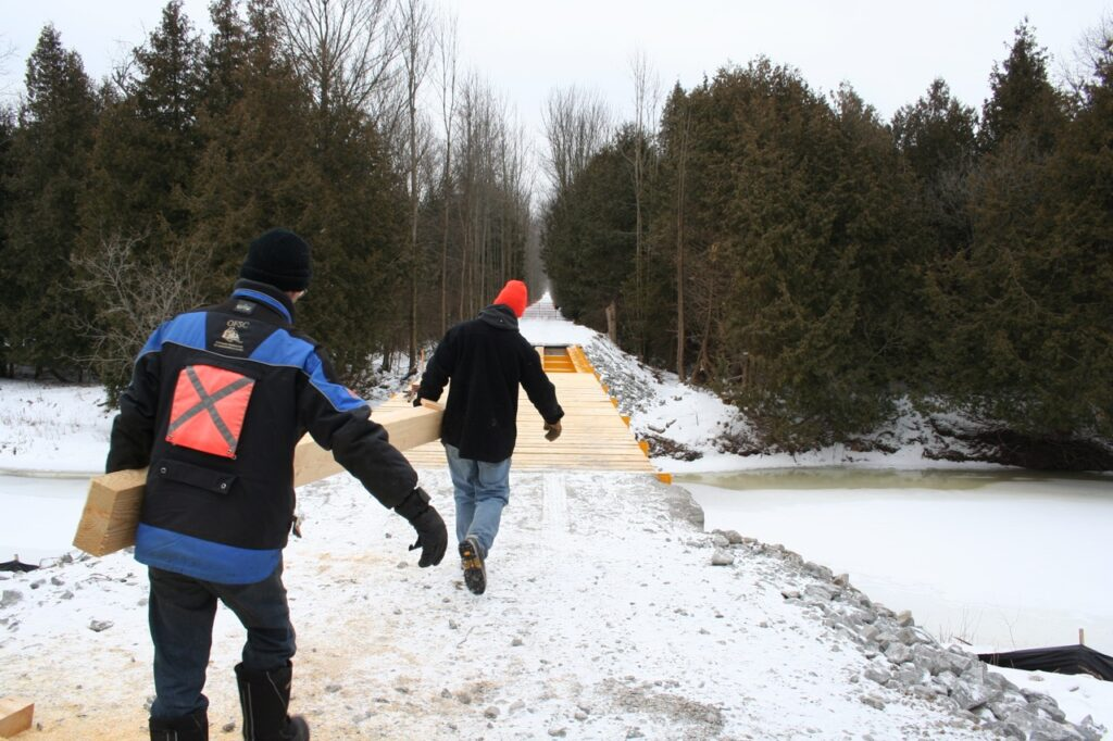 Lots of snowmobile club volunteers are required to get trails ready for winter.