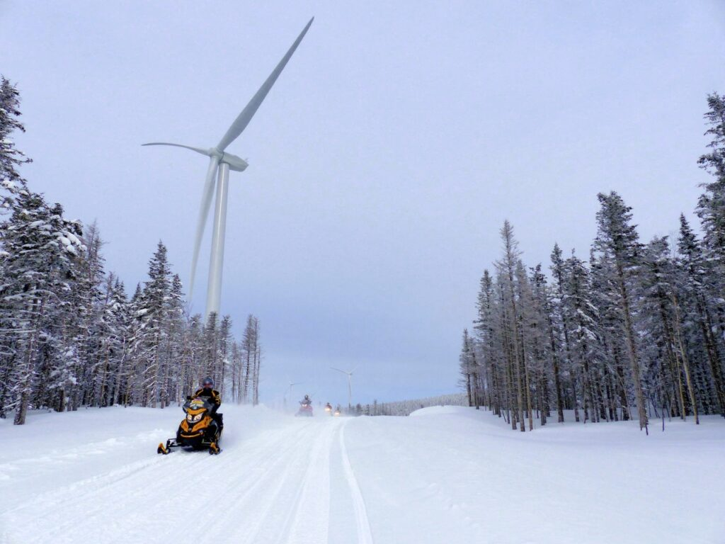 Visit wind turbines when you snowmobile New Brunswick Northern Odyssey.
