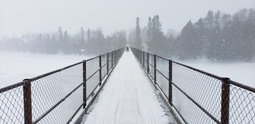 Some bridges are only wide enough for one snowmobile to cross at a time