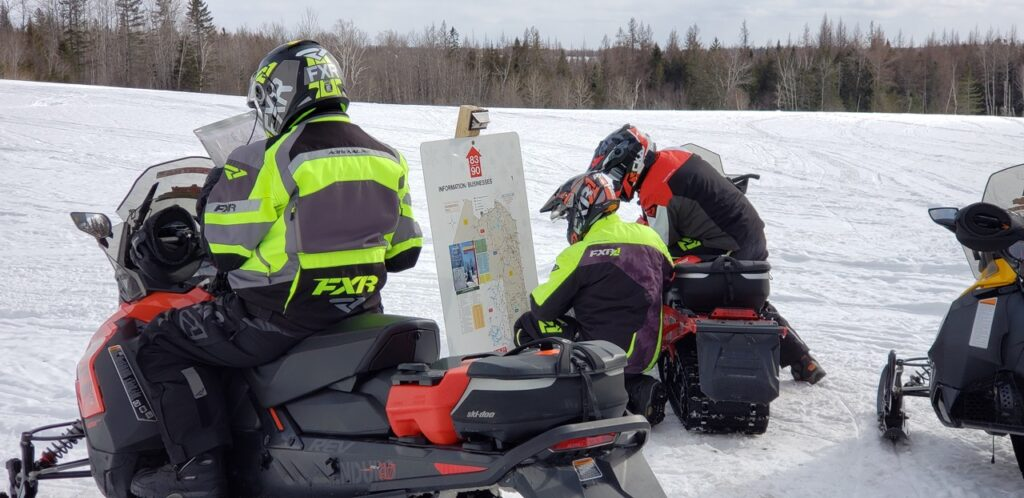 Trail signs for snowmobiling Northern Maine require careful study.