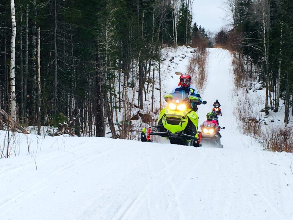 All snowmobile tour types can offer groomed trails like this.