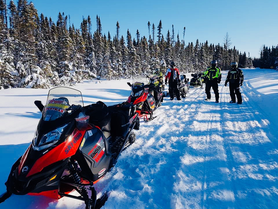 Taking a break on the trail is common among all snowmobile tour types.