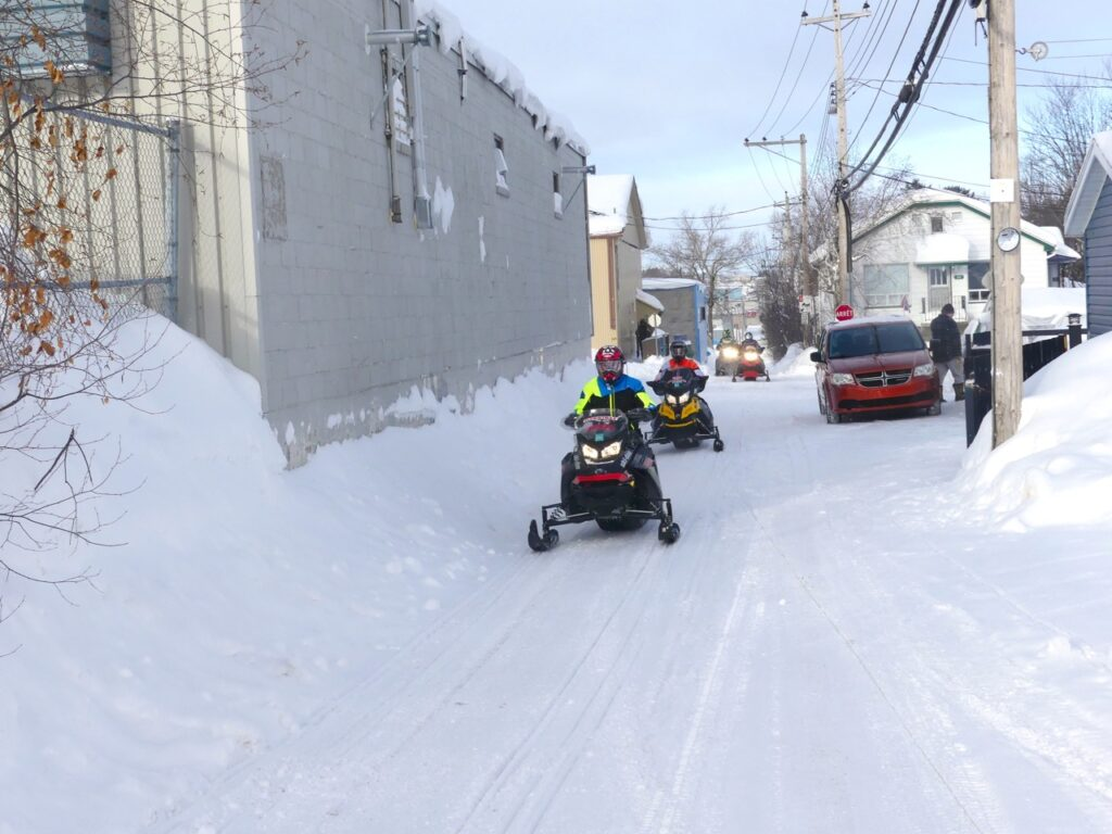 A good snowmobile staging hotel provides trail access on the snow.