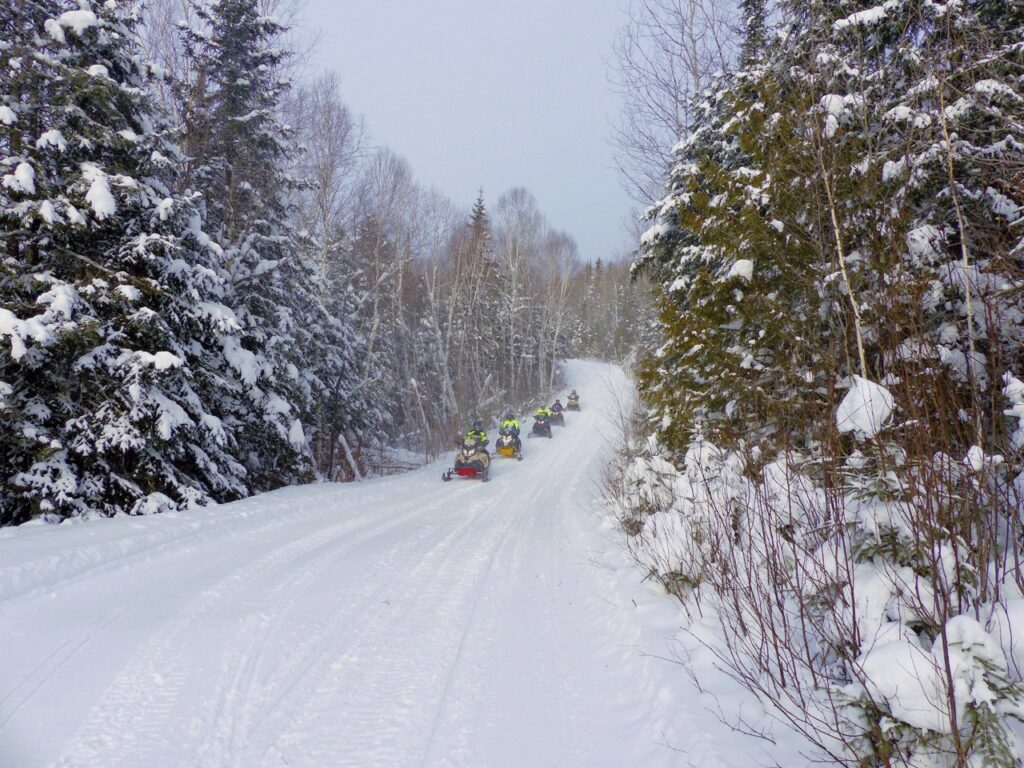 Mont Laurier snowmobiling includes scenic forest trails like this