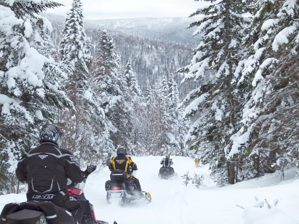 To find scenery like this, choose a saddlebag ride from snowmobile tour types.