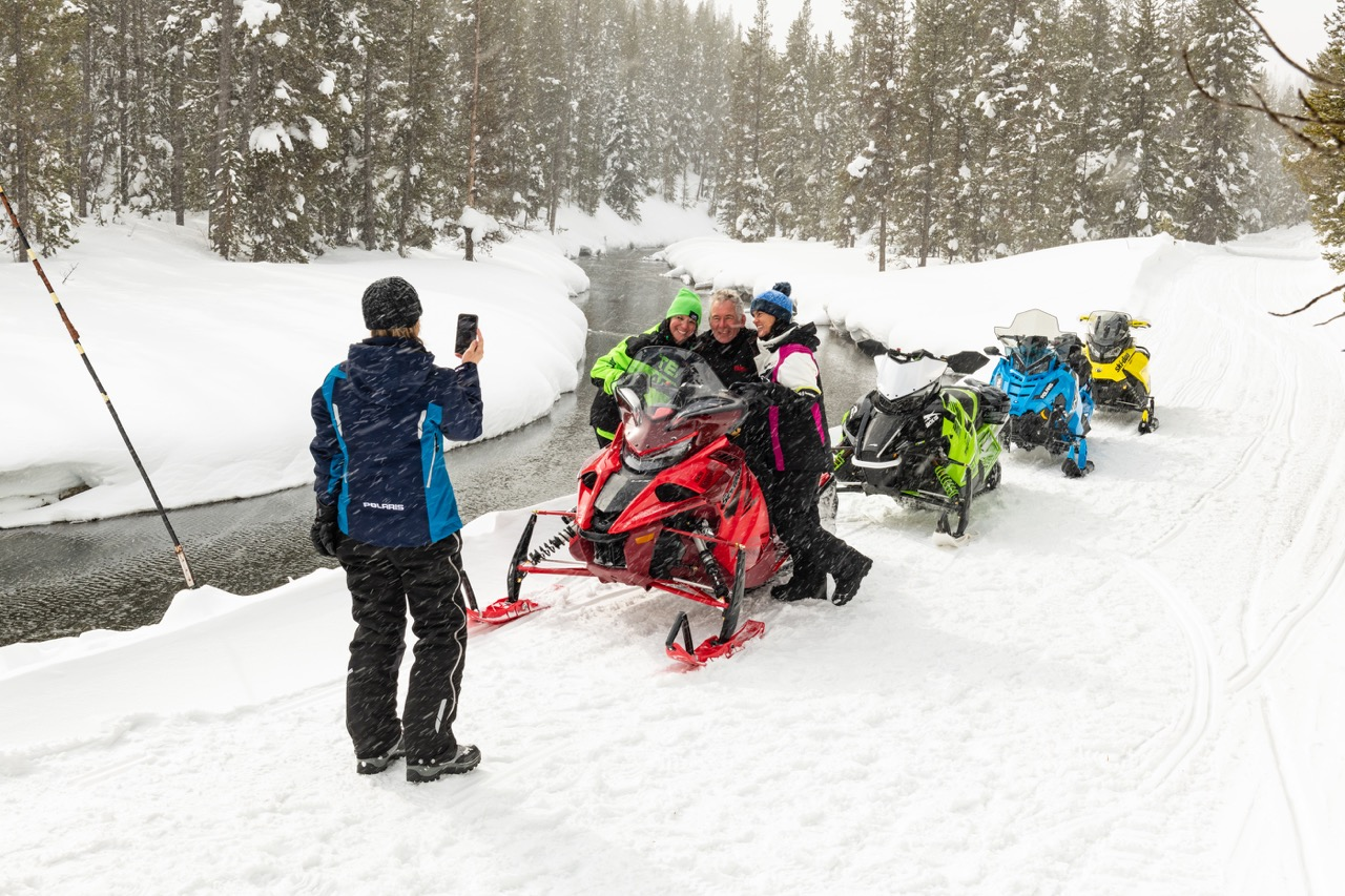 Snowmobile beginners tips include how to keep your digital devices warm.