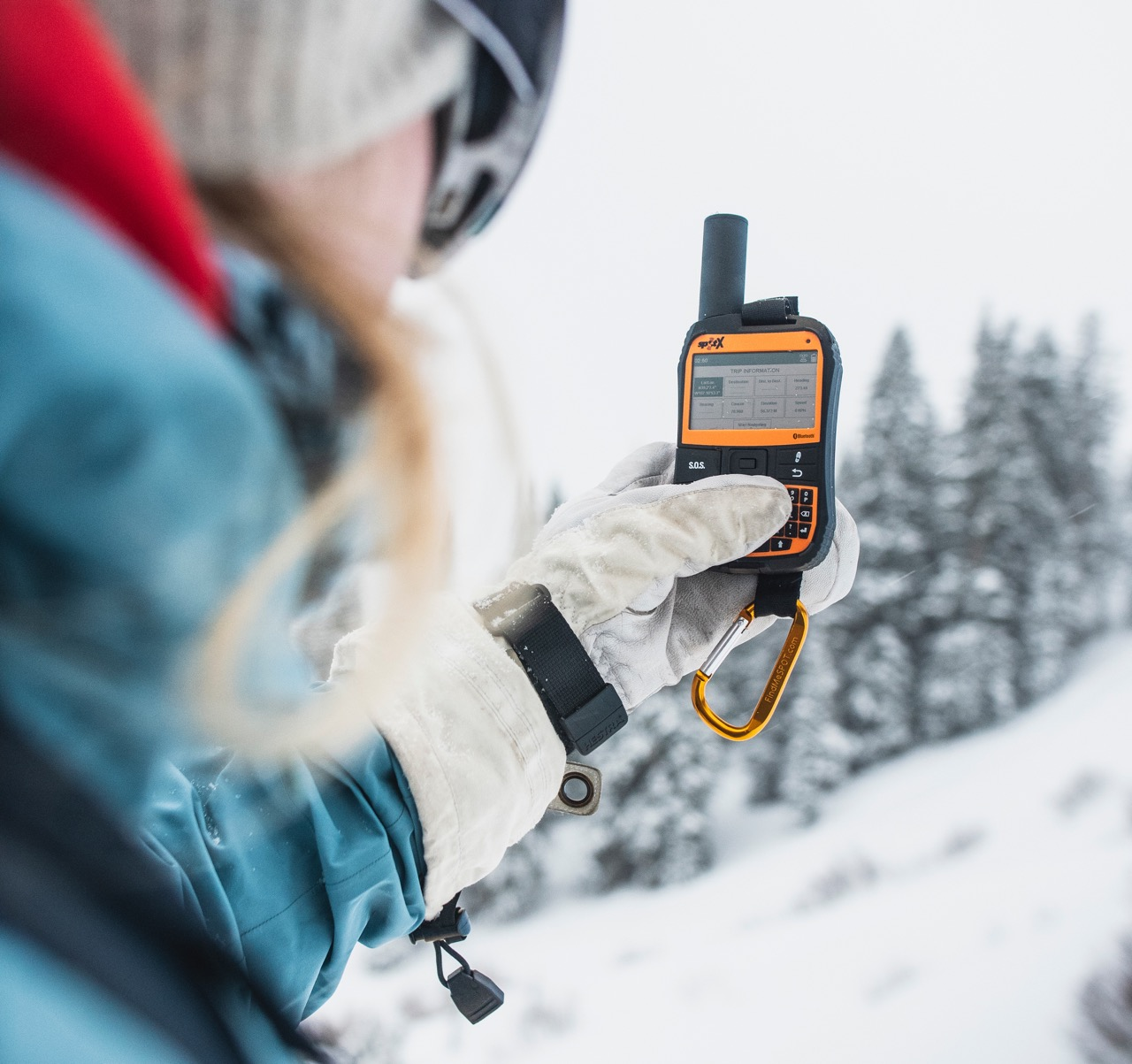SPOT X for snowmobiling provides SOS emergency contact.