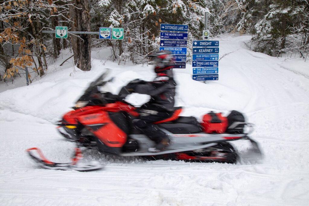 Good trail signage helps to snowmobile Muskoka Ontario.