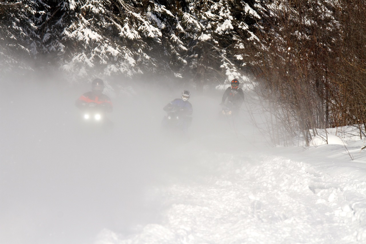 Staying warm while snowmobiling on a hard trail ride.
