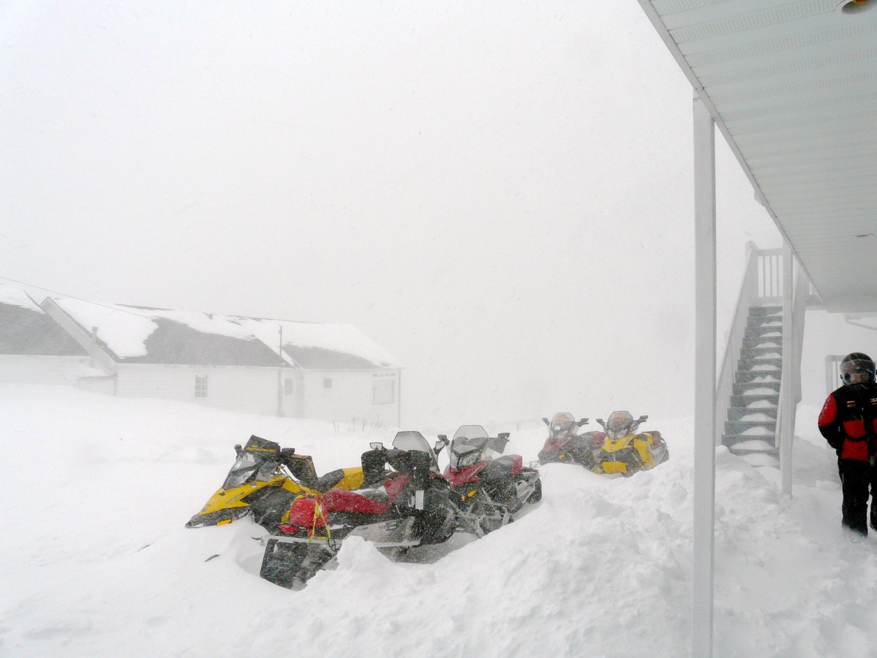 Cold plus deep snow make staying warm while snowmobiling more of a challenge.
